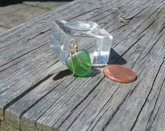 small green smooth beach glass pendant