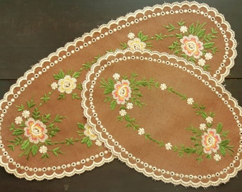 Set of two vintage oval machine embroidery doilies with flowers