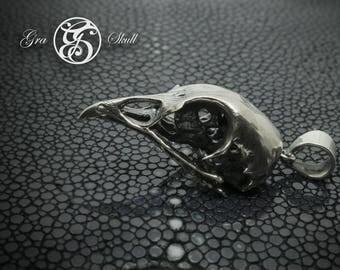 Silver quail skull pendant