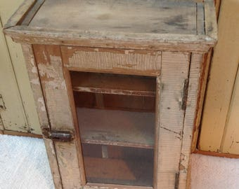 Rustic  wall cupboard with glass door
