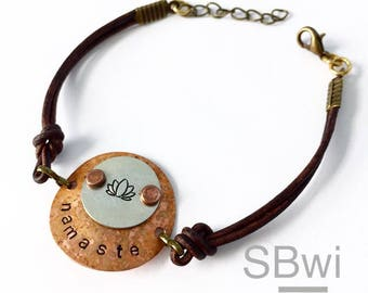 Namaste bracelet with lotus detail in copper, pewter and leather