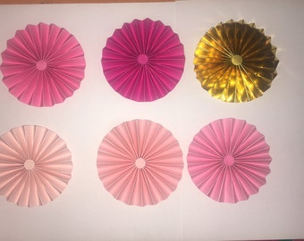 5 pink paper rosette and 1 silver foil rosette 4 inch