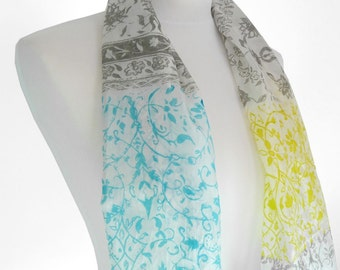 Screen printed silk habotai scarf with unique intricate ethnic pattern in blue, yellow and grey