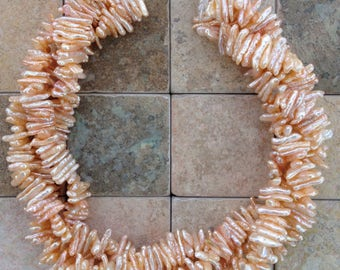 Reduced Peach colored freshwater pearls