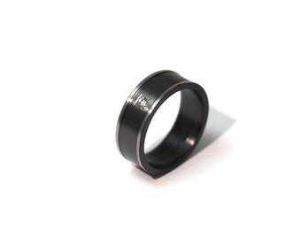 Black & white zirconium ring with sapphire
