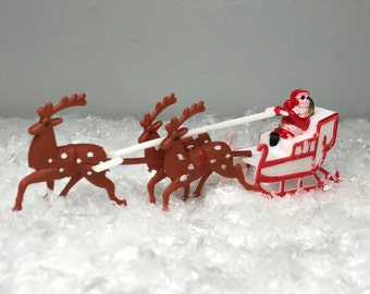 small vintage plastic Christmas decoration Santa in his sleigh