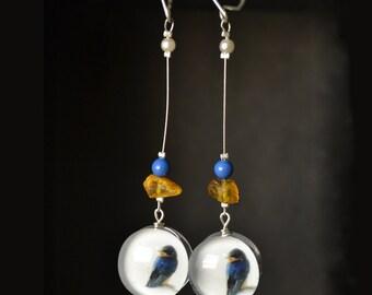 Long dangling earrings with birds, glass earrings with amber