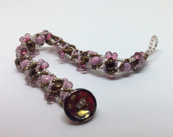 Droplet: Delicate and flexible with a mixture of pink and Gold Bracelet.