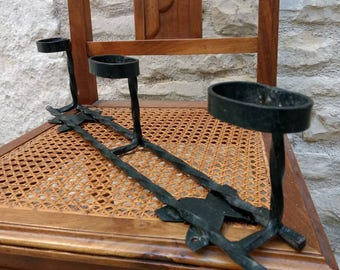 Mid century French industrial vintage, twisted wrought iron coat rack with three pegs in black.
