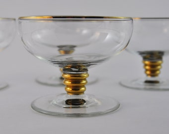 gallerymichel Set of Four Art Deco Champagne Glasses with Gold Rims and Bubble Stems