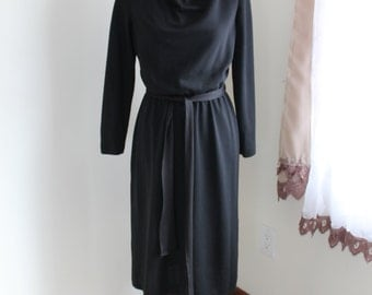1970s Black Dress by Connections, Size Medium Long Sleeve Belt Drape Neck