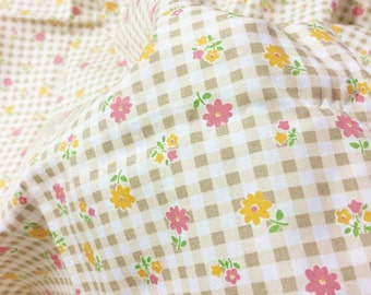 cute flower on brown plaid background of 100% Cotton Fabric by the yard .