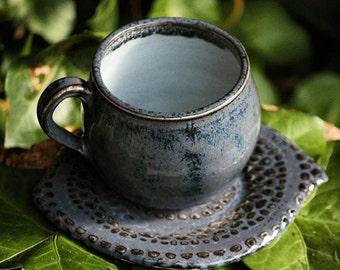 Ceramic Tea/coffe cup an saucer.Midnight-blue,light blue inside.