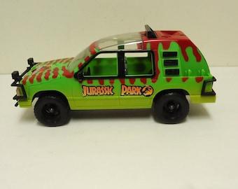 vintage jurassic park toy car vehicle,kenner jungle explorer truck 1993 universal studio,jurassic park movie prop decor,jungle safari car
