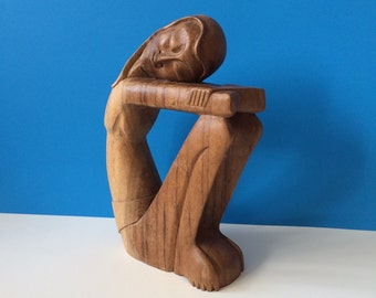 Mid-century carved wood female figure at rest