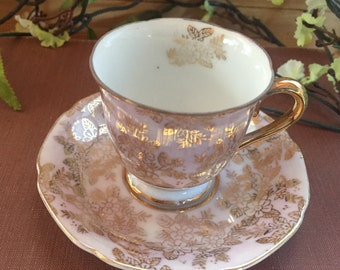 Vintage, small, pink teacup and saucer made in Occupied Japan