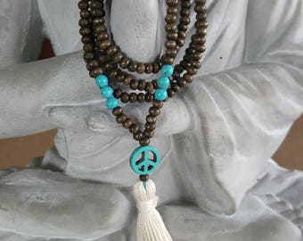 Wood necklace with reconstituted turquoise  and tassel.