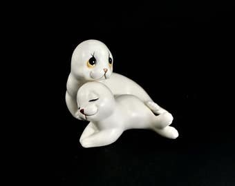 Vintage white seal porcelain figurines - mama and baby, two, pair, set