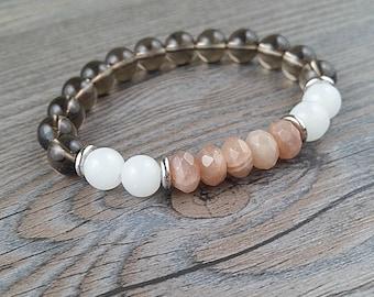 Bracelet of fine stones smoky quartz, white quartz and stones of sun 8mm
