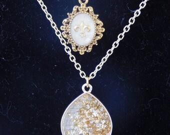 Gold Fleur de lis double chain necklace.
