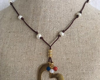 Necklace in brown nylon thread, with pearls and a  gold filled heart