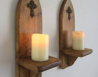 Pair of Church / Gothic style wall sconce candle holders with Antique bronze cross / crucifix decoration , various sizes available