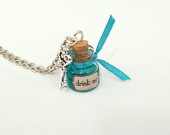 Alice in Wonderland drink me Alice chain necklace glass bottle petrol