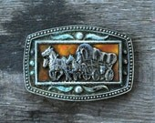 vintage covered wagon stagecoach belt buckle / western 1970's belt buckle horses wagon
