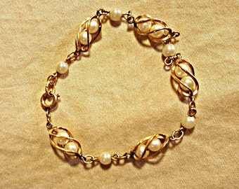 Vintage Caged Pearl Gold Tone Bracelet Costume Jewelry 1960s Twisted Cage Links Spring Clasp