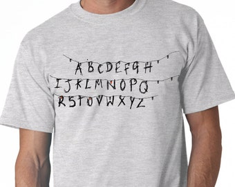Stranger Things - T-shirt - Hit TV Show Inspired - Hand Screen Printed - Alphabet - Fairy Lights Light Up Run!