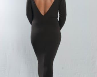 Black tube dress, deep back neck edge, boat neck front midi length