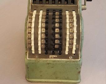 Vintage Hoffritz mini adding machine.