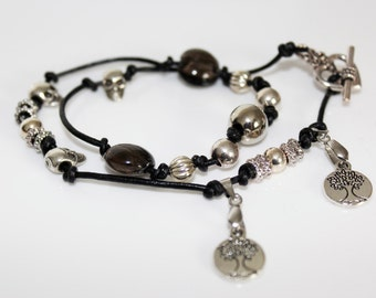 Silver and leather wrist wrap