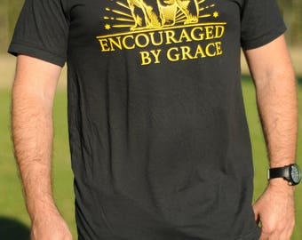 Encouraged By Grace --- Color: Vintage Black --- Graphic Screen Printed T-Shirt