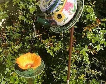 orange flower tea pot birdfeeder