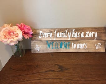 Welcome sign with teal color