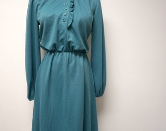 70s ruffled secretary blue green dress . fits a small to medium