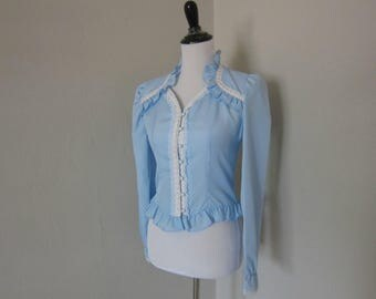Vintage 1970s Blouse by Cindy Collins, Victorian Style Light Blue Poly Long Sleeved Top with Lace/Ribbon Trim, Ruffles, & Faux Pearl Buttons