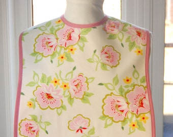Church Flowers Reversible Fabric Adult Bib - pink floral cotton print with solid light pink lining - inner absorbent flannel layer