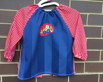 Toddler's long sleeve waterproof art smock, age 2-3 years. Blue and red featuring front end loader.