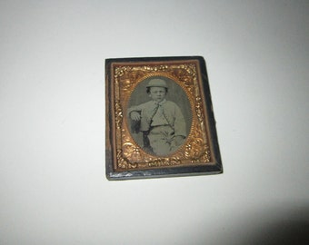 antique cased photo -1/2 case - boy with hat and hand tinted neck ribbon - civil war era, late 1800s