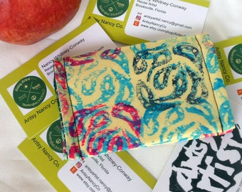 Hand printed paisley ID wallet business card holder recycle reuse vegan my version of paisley in red, green blue on yellow