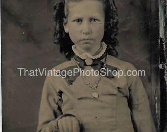 Tintype Photograph  of a Serious little girl