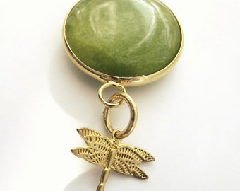 green pendant with dragonfly