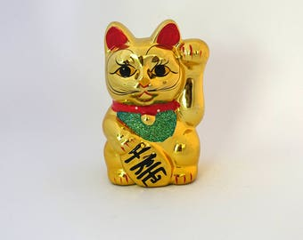 Vintage Japanese Maneki-neko shiny gold lucky cat ceramic figurine piggy bank, beckoning cats