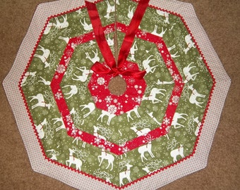 """Handmade Quilted Tree Skirt 32"""" wide Green Pearl Reindeer fabric with silver."""