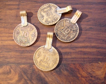 Moroccan tarnished gold colour very small  10 francs coin with brass bail or loop