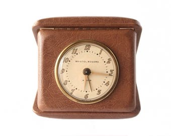 Vintage travel alarm clock, Parts clock, Works, runs slow. Leather case clock, Bristol-Rogers USA