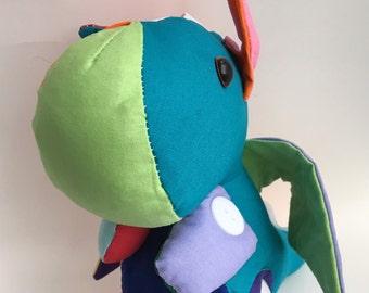 multi coloured rainbow dragon fabric stuffed toy