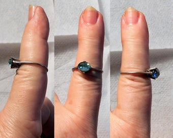 1 Dainty Rhinestone Ring Thin  Unmarked Silver, Size 6 1/2,   1 Blue Foiled Rhinestone,   Only 29.00